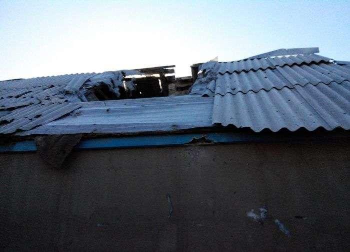 Житель Донбасу оцінює збиток (34 фото)