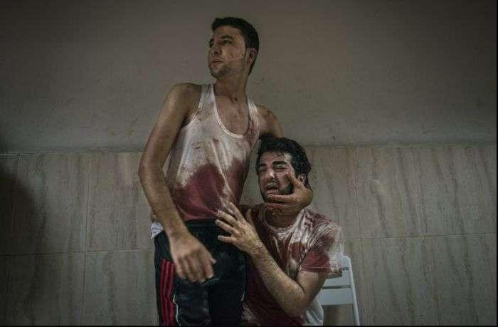 На фотоконкурсі World Press Photo кращим фото стало зображення пітерської ЛГБТ-пари (4 фото)